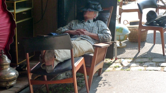 Sleeping at the flea market, Sunday afternoon. Photo by Julie Seyler