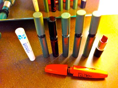 7 mascaras and one red lipstick