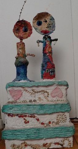 The weddong cake. Papier-mache and acrylic paint.