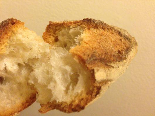 Tearing open bread