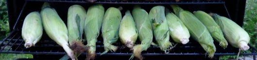 Unhusked corn on grill.