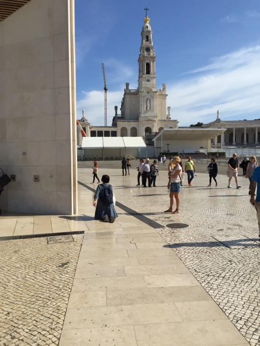 Fatima. A woman makes a pilgrimage.